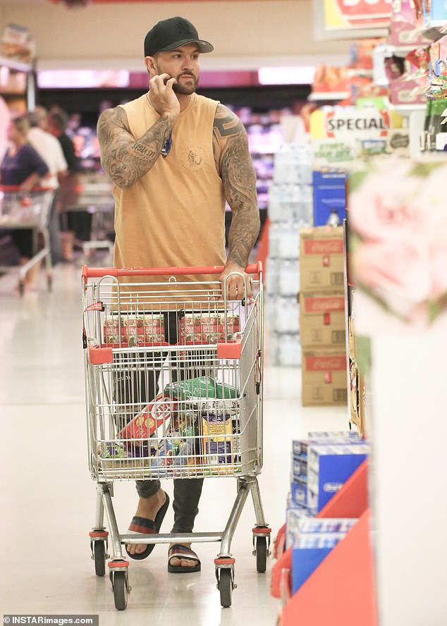 Dinner for one? Married At First Sight star Dan Webb (pictured) appeared downcast while grocery shopping alone in a Brisbane Coles on Wednesday... after shock split with Jessika Power