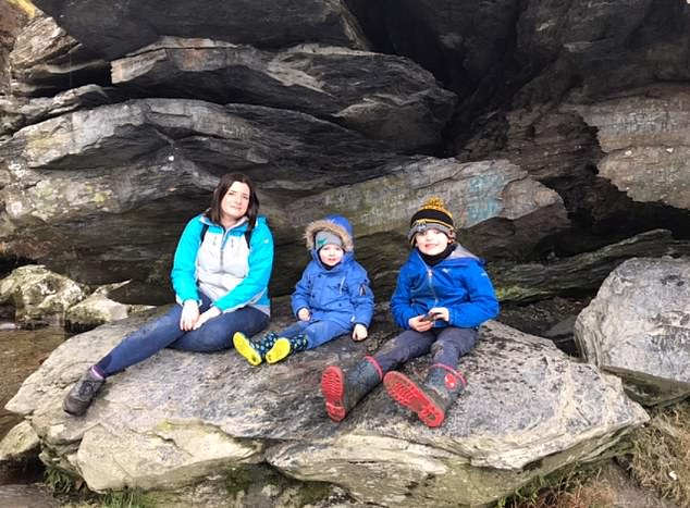 Mrs Hutchinson, pictured with her children, said: 'The doctors made me feel like I was overreacting, which I then thought everyone else thought, and that left me terribly anxious.' Her anxiety has now reduced