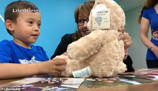 Sandra had another gift for Josiah: a teddy bear with an electrocardiogram recording of Rivera's heartbeat that plays when the stomach is pressed (pictured)