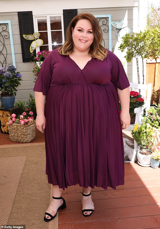 Lovely: Chrissy Metz stopped by the Hallmark Channel's Home & Family show Wednesday wearing a maroon short-sleeved dress with cross-over bodice and black sandal flats