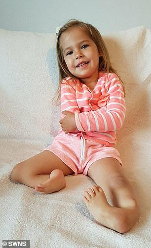 The youngster was born with the one-in-a-million condition tibial hemimelia, which caused her legs to be 'backwards' (pictured)