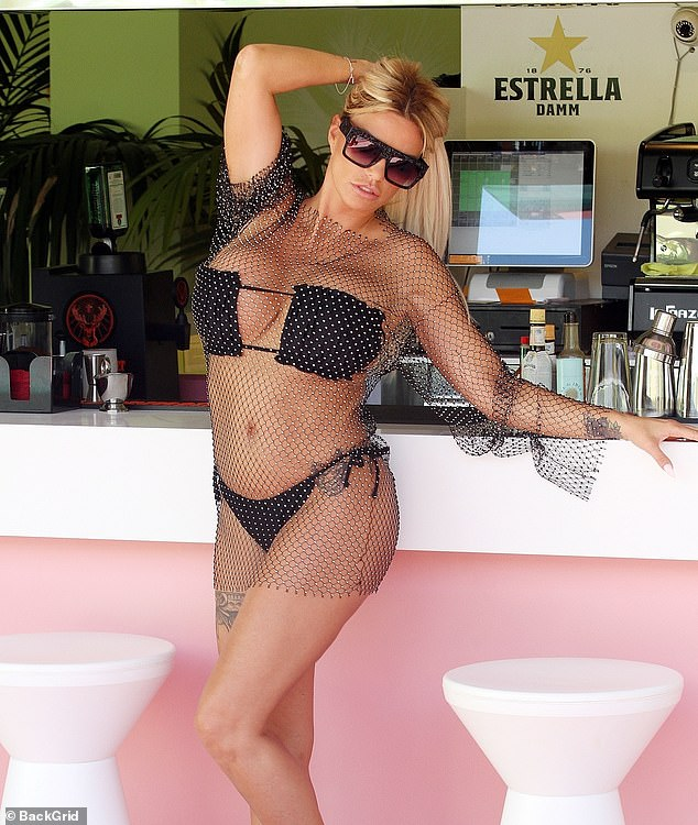 Dazzling diva:As a leading lady in her own reality television series, it's no wonder the TV star modelled her curves in a dazzling beaded mesh dress worn over her raunchy bikini