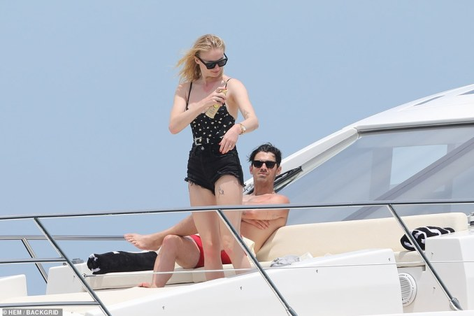 Covering up: At one point, the GOT star slipped on a pair of distressed black denim shorts over her swimming costume