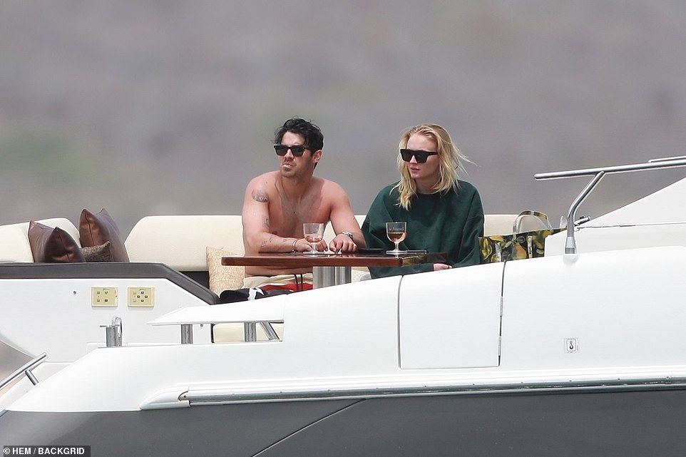 Precious moments: The couple enjoyed moments of quiet during their time aboard the yacht
