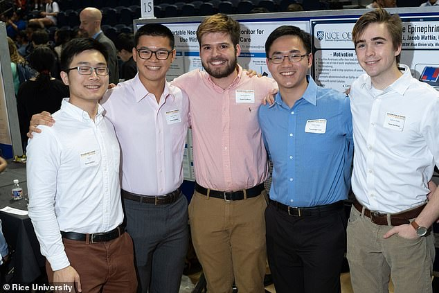 The inventors: The team of juniors and one freshman at Rice University were inspired to make the pen because one of them, Justin Tang (second left), has a severe peanut allergy