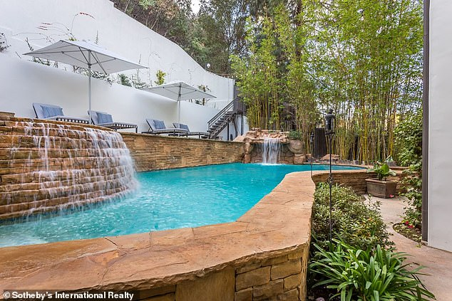 Pool:The backyard features a few covered patios, plus a built-in barbecue and a waterfall-fed swimming pool and spa