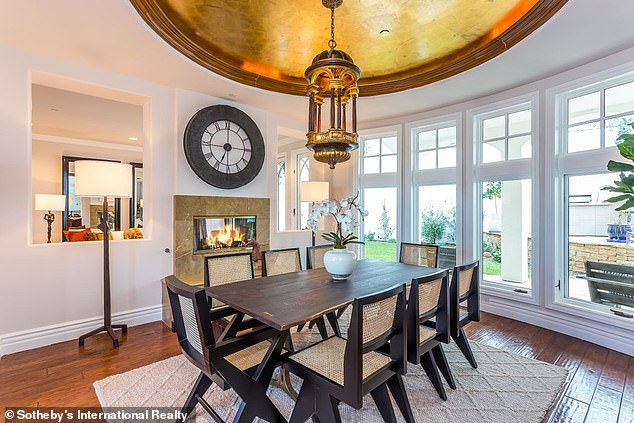 Dining room:The home features an elevated porch and foyer that leads into the formal living and dining rooms, which are separated by a fireplace