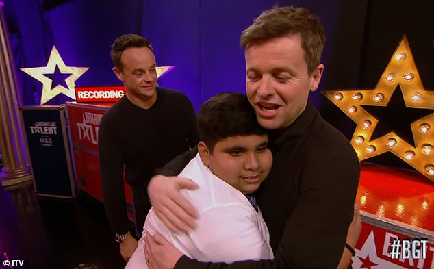 Pleased: After he wowed the audience, Dec gave the teen a hug and said: 'Make us proud, I'm sure you will you made us happy'