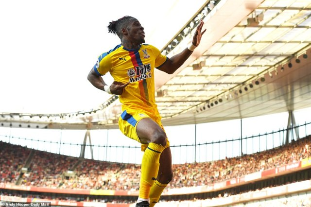 Wilfried Zaha is delighted after his goal, which was scored in the 61st minute, made it 2-1 to Palace