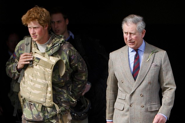 The royal photographer said shooting the royal family and royal children is like no other job (pictured: Prince Charles with Prince Harry)