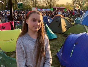 Greta poses for a photo at the Extinction Rebellion camp at Marble Arch in London on Sunday