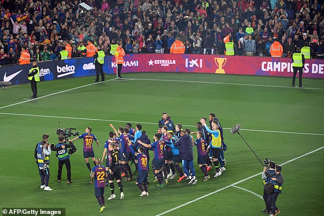 The triumphant Barcelona squad celebrate in style in front of the jubilant home support