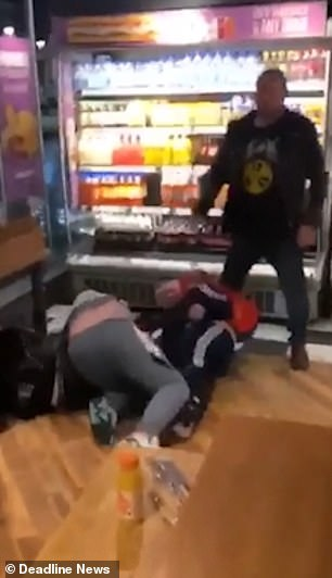 But she is fought off by another woman and also falls over