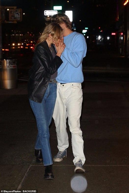 Jordan Barrett passionately kisses a mystery blonde in New ...