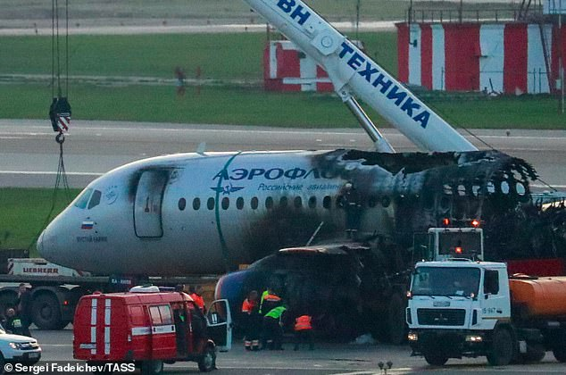 """Wreck: The burned-out remains of the aircraft at the Moscow airport after a crash landing, which had been handled """"expertly"""" according to an aviation commentator"""