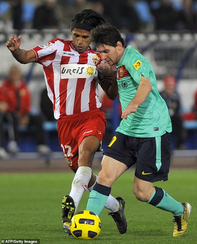 Vargas in action against Messi in 2010 during Almeria's heavy defeat against Barcelona