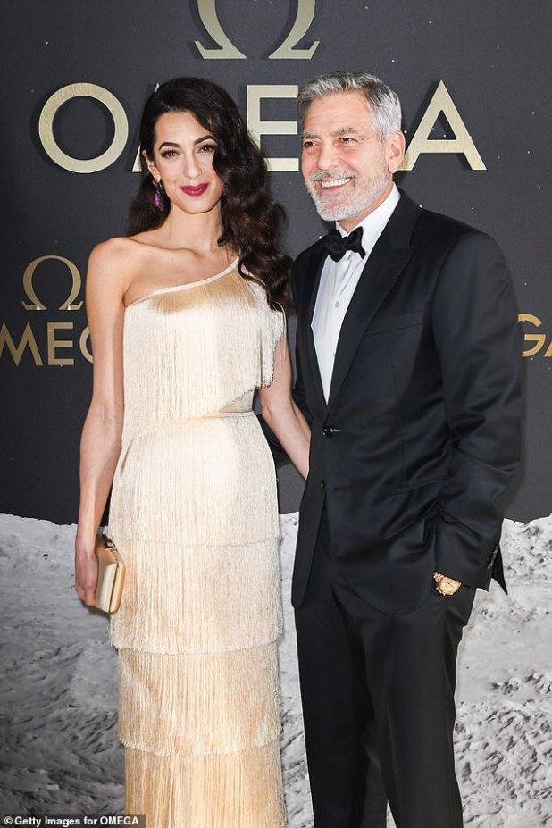 Simply sophisticated: George Clooney and his wife Amal demonstrated their timeless style at the Omega 50th Anniversary Moon Landing party on Thursday night