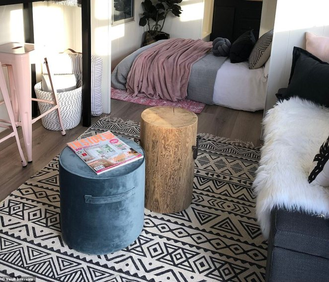 'The lounge area has a storage ottoman, patterned rug and some small side tables that can also act as extra seating and the bed is actually a sofa bed so that can also fold up allowing more floor space if required,' she said