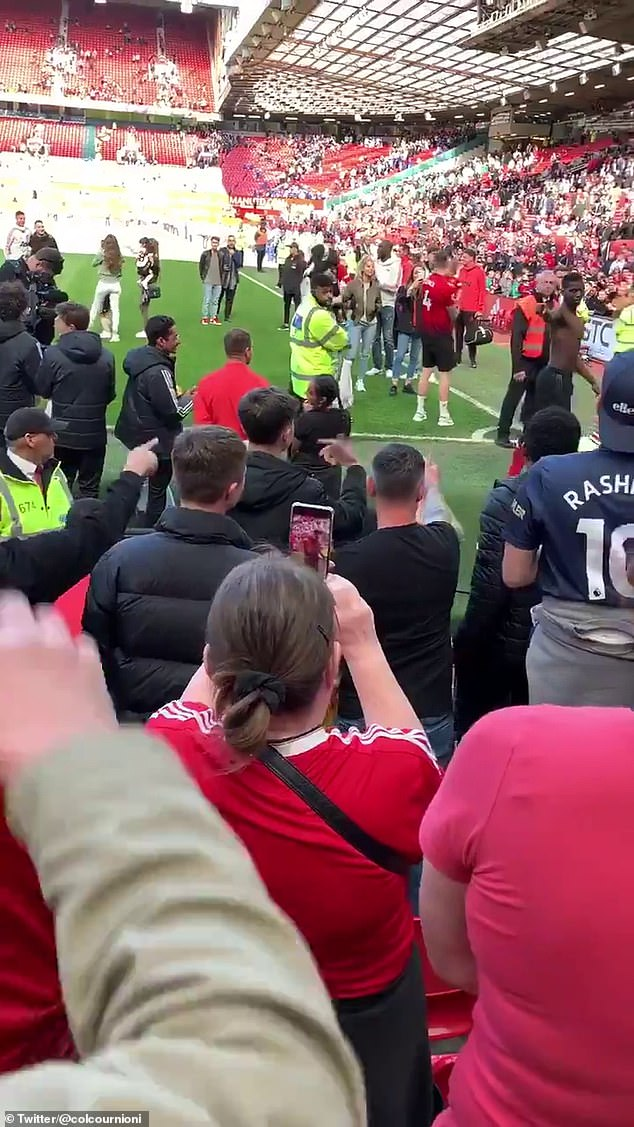 Pogba appears to clap the supporters and point at them sarcastically before leaving the field