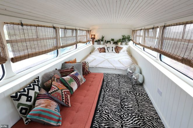 The bedroom upstairs is fitted with a striking animal-print carpet and provides comfy bedding for three guests