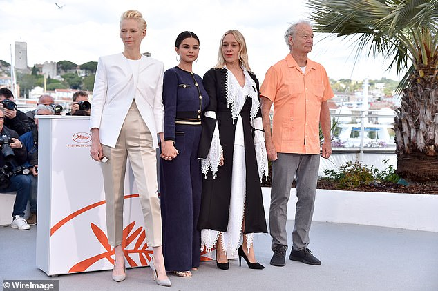 All-star cast:The multi-talented star looked gorgeous in a chic navy and gold suit as she posed with her co-stars Tilda Swinton,Chloe Sevigny and Bill Murray