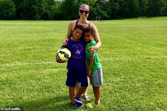 The couple's two children, Gus and Freddy, are being adopted by Tessie's sister and her husband. Pictured: Tessie with her sons on the soccer field where she and John met