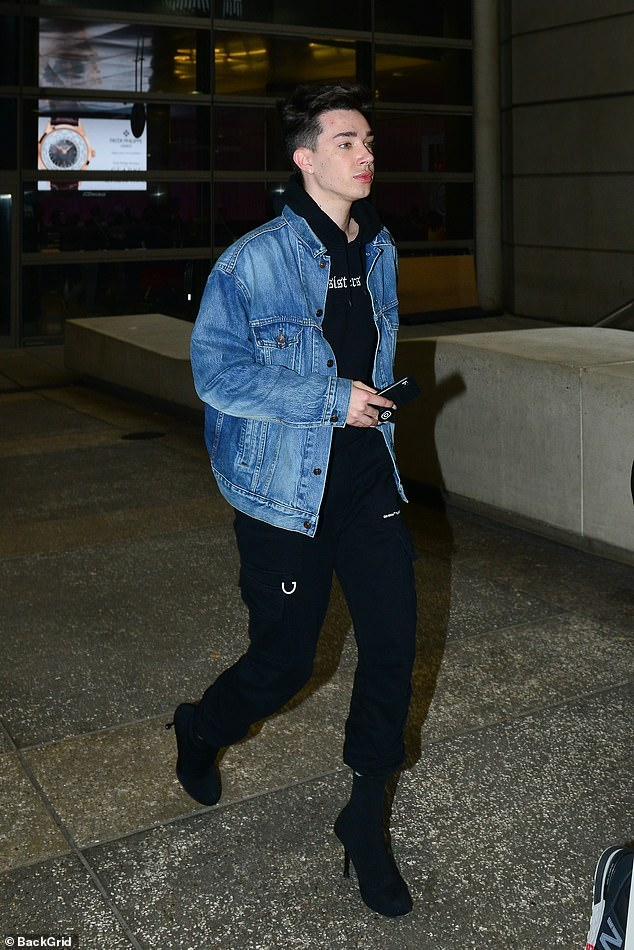 Makeup blogger James Charles, sporting Prada stiletto-heeled boots as he arrived today at LAX Airport, has lost 3.13 million subscribers since his YouTube feud with Tati Westbrook