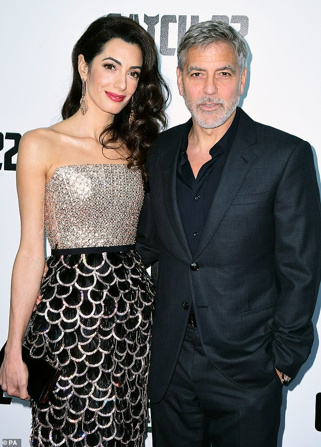 Elegant:Amal exuded glamour in an extravagant black sequined dress with a gold bodice as she cosied up to her actor husband
