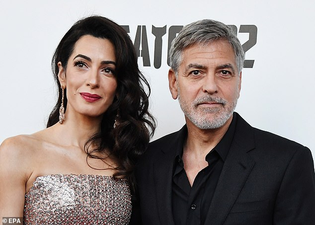 Supportive wife: Amal stood by George's side ahead of the screening in London
