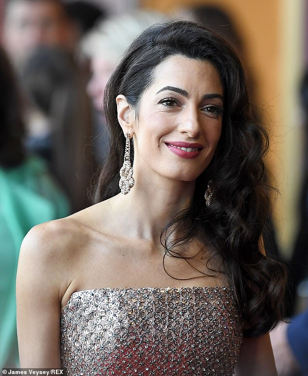 Stunning: The raven-haired beauty donned a dazzling pair of drop-earrings