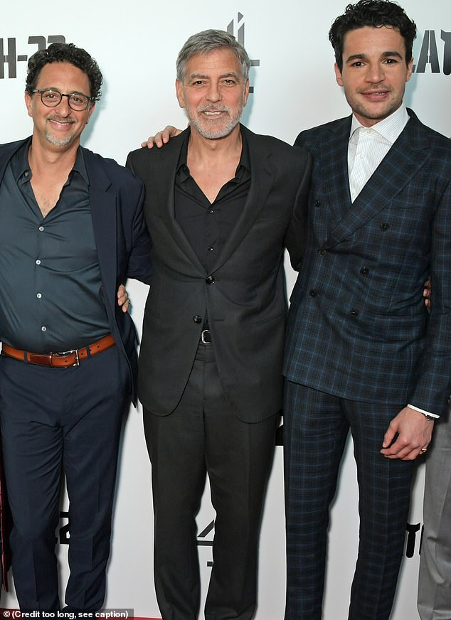 Standing proud: George stood with the film's producer Grant Heslov (L) and fellow actorChristopher Abbott (R)