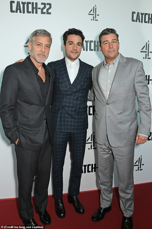Co-stars: George posed with Catch 22 co-starsChristopher Abbott (C) and Kyle Chandler (R)