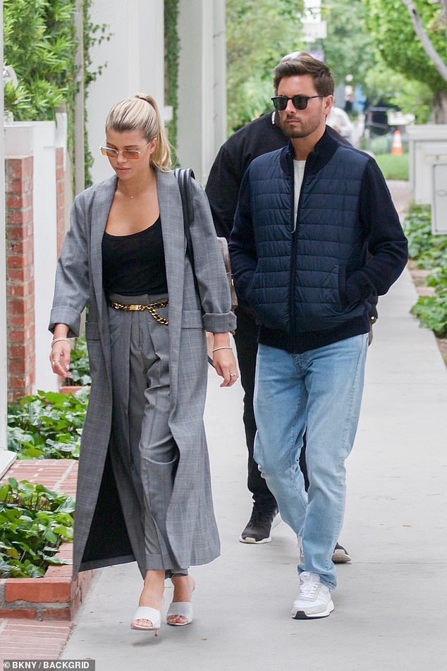 Relaxed: Disick, who shares three children with ex Kourtney Kardashian, was more casually attired. He paired blue jeans and white sneakers with a black zipper jacket over a white tee