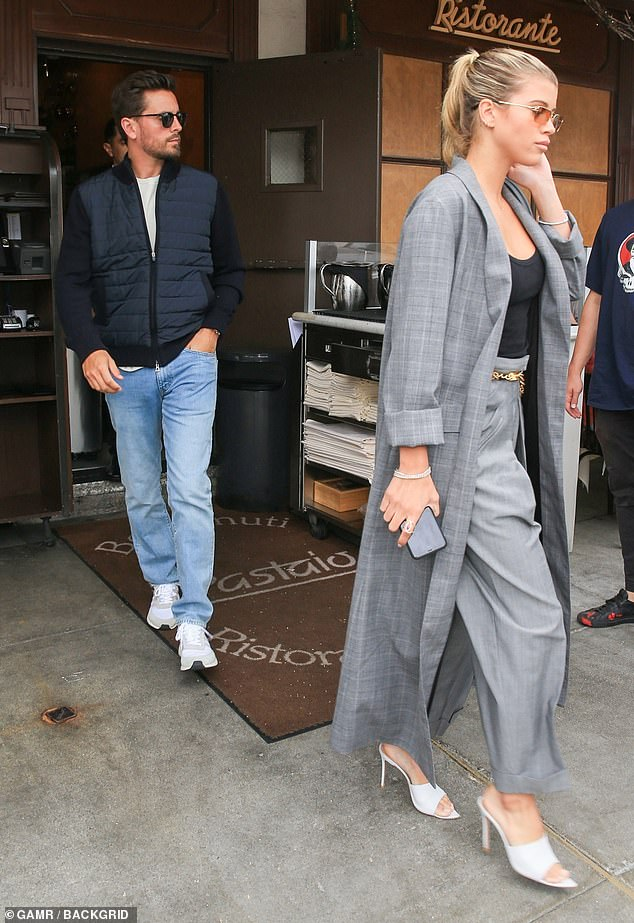 May-December couple: The daughter of singer Lionel Richie strode out in front of her reality star beau as they left the restaurant and headed out on their retail expedition