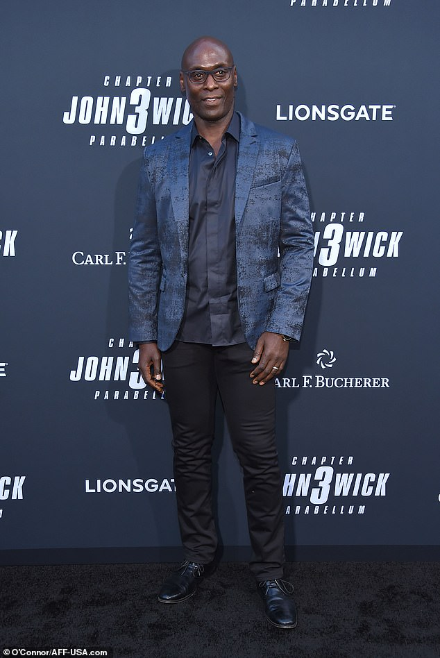 Charon: Lance Reddick, who plays Charon, poses on the red carpet