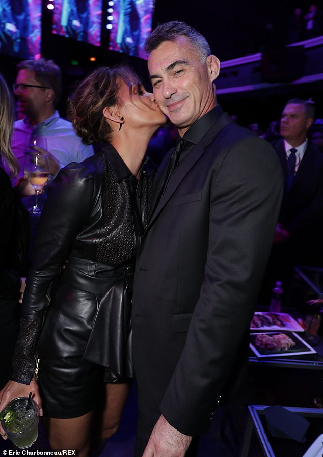 Fun: Halle happily placed a kiss on director Chad Stahelski's cheek