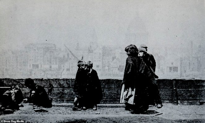 Street children play on Bankside in London, with St Paul's Cathedral visible in the background in 1893. The cathedral in its current form dates back to 1697, so had already been an established feature of the London skyline for two centuries