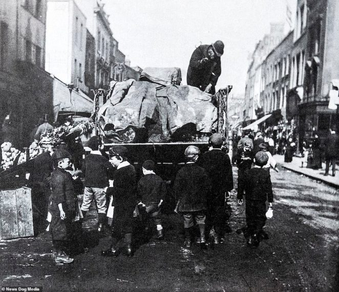Children follow an ice cart along a road in Lambeth in 1892, as they collect the pieces that fall off. Ice used to be distributed around the capital having being stored in underground areas, until commercial electric refrigeration became widespread
