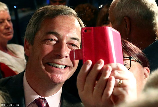 Nigel Farage poses for a selfie during a Brexit Party campaign event at the Sugar Hut nightclub loved by TOWIE'S stars