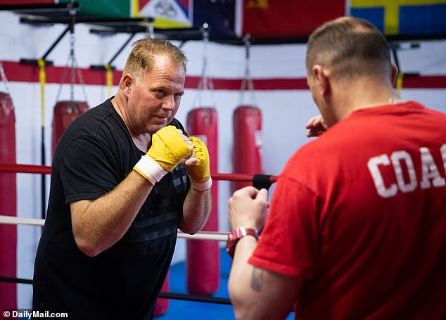 Markle invited DailyMailTV to a training session at a boxing gym in Philadelphia where he was taken through shadow boxing drills, bag work, speed ball and jump rope by his sparring coach