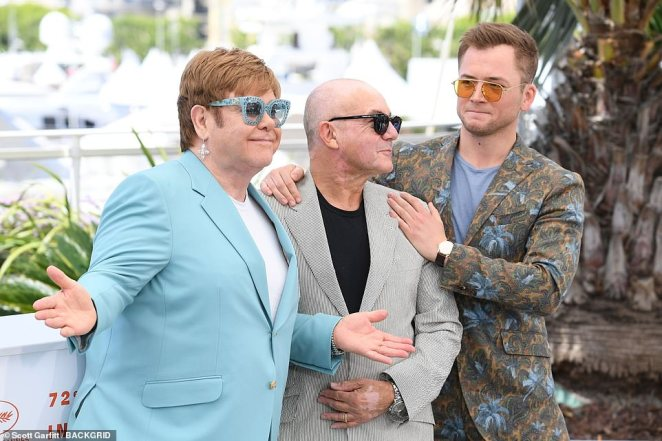 Iconic: Bernie Taupin (centre) the songwriter behind Elton's biggest hits, made a surprise appearance