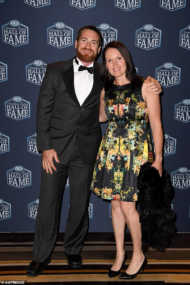 AFL legend Jason Akermanis (pictured with wife Megan) has faced off with a golf club president to protest his innocence after being banned for threatening other golfers