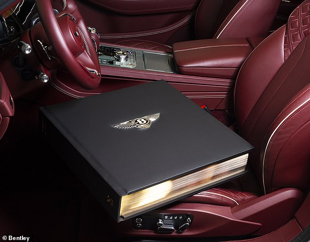 Light reading: The £200,000 Bentley books each weigh in at 30kg - the heaviest book ever produced telling the story of a car brand