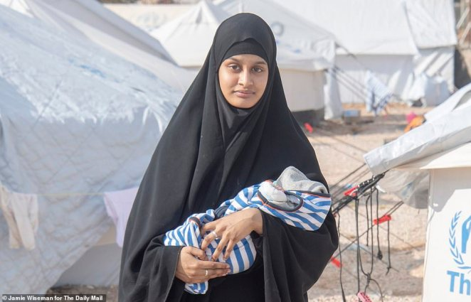 Shamima Begum is pictured with her son, who later died, in a refugee camp in Kurdish Syria. She had her citizenship removed by the Home Secretary Sajid Javid