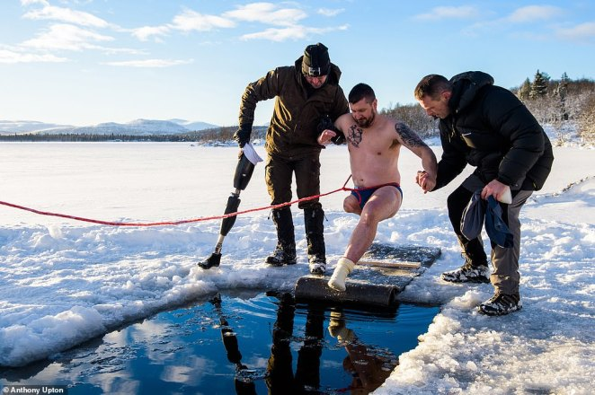 The Royal Marines Club organised a respite holiday in Norway for Baz Barratt, who lost his leg after an IED attack in Afghanistan. He is pictured entering an ice hole