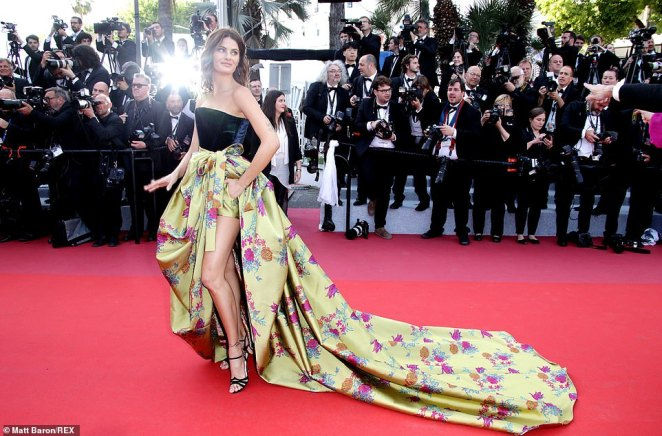 On trend: Isabeli Fontana also sported a golden train with floral detailing