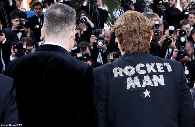 Icon: Elton, posing alongside his husband David Furnish, proudly sported his Rocketman blazer for the premiere