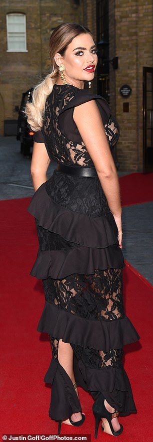 Got the look: Her skirt fell in layers around her pins and also sported a lace frill