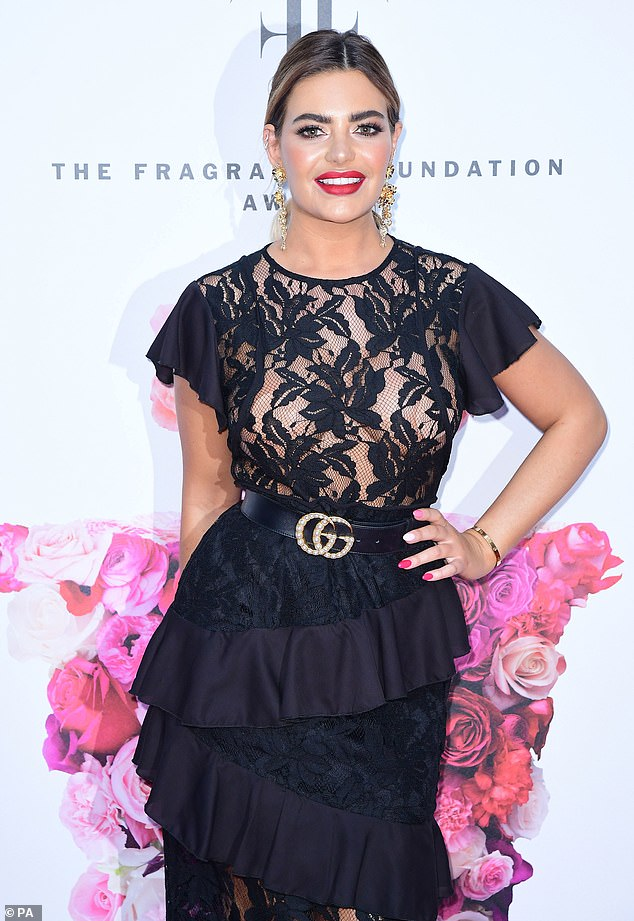 Beauty: She nipped her waist with a black and gold belt, adorned with pearls, and completed the look with a matching skirt