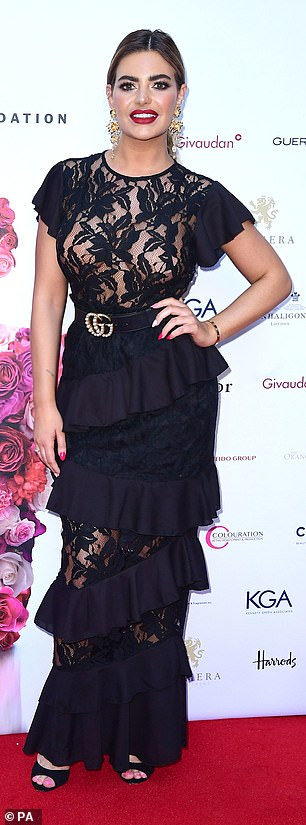 Glamour gal: The former-Love Island bombshell, 25, turned up in a lacy black top, with a sheer floral design and short peplum sleeves
